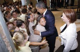 Barack with Prime Minister Julia Gillard and schoolkids .
